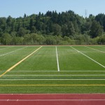 District Installing Coated Rubber Infill on New All-Weather Fields