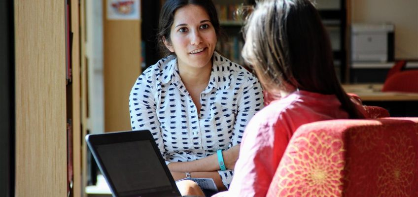 Counselor working with student