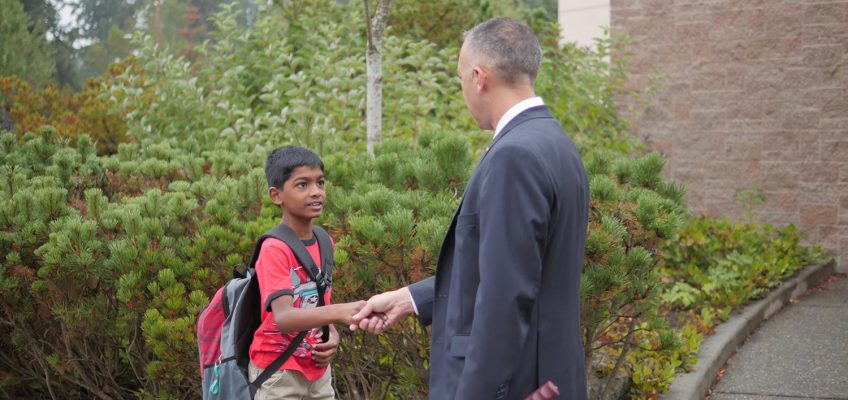 Dr. Duran Greets Student